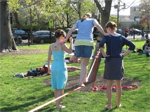 Young women practicing tightrope walking in Wicker Park